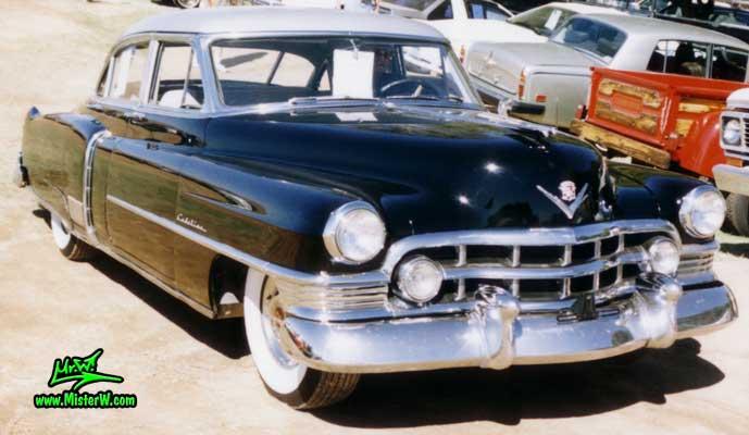 Photo of a black 1950 Cadillac Fleetwood Series Sixty Special Sedan 4 Door Hardtop at a classic car auction in Arizona. 1950 Cadillac Fleetwood