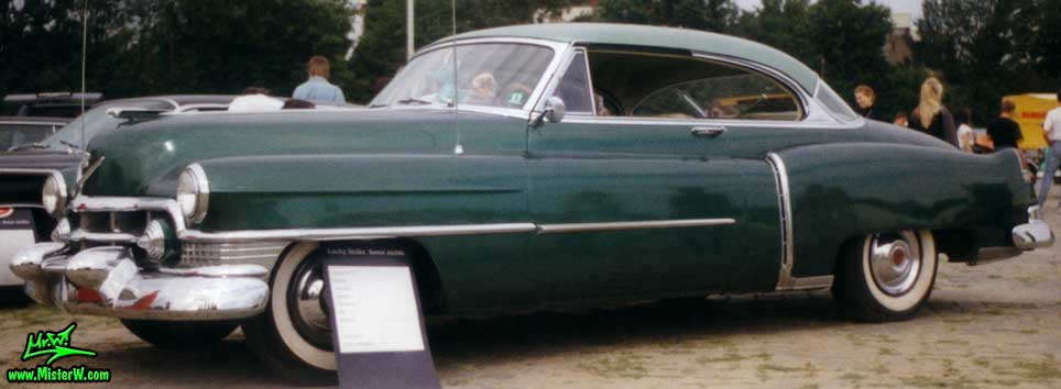 Photo of a forest green 1951 Cadillac Series 62 2 door hardtop coupe at a classic car meeting in Germany. 1951 Cadillac Series 62 hardtop coupe