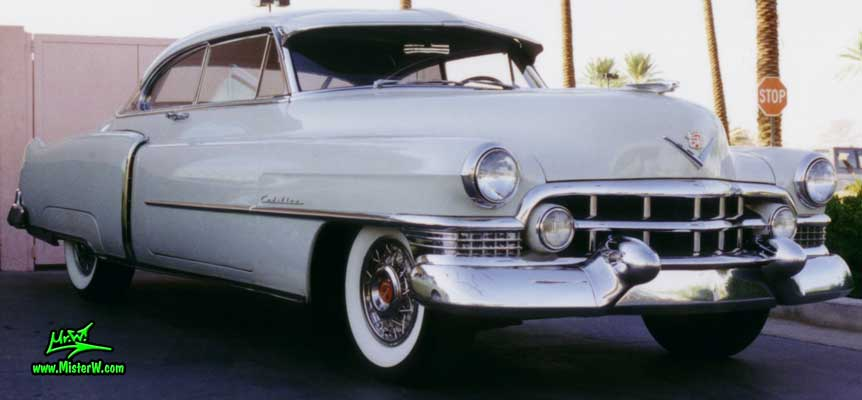 Photo of a white 1951 Cadillac Series 62 Coupe 2 Door Hardtop at the Scottsdale Pavilions Classic Car Show in Arizona. White 1951 Cadillac Coupe