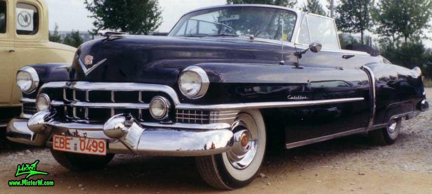 Photo of a black 1951 Cadillac Series 62 Convertible at a classic car meeting in Germany. 1951 Cadillac Series 62 Convertible
