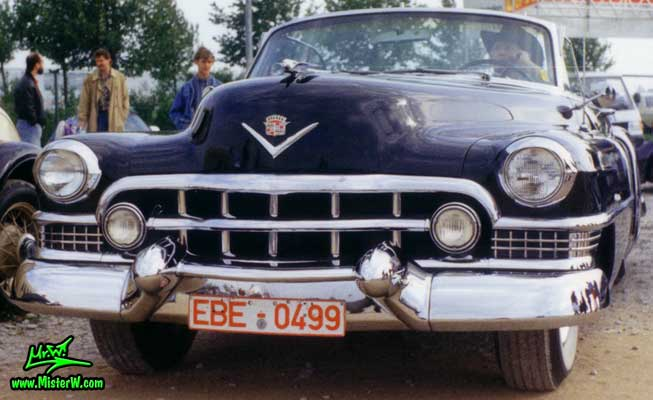 Photo of a black 1951 Cadillac Series 62 Convertible at a classic car meeting in Germany. 1951 Cadillac Convertible