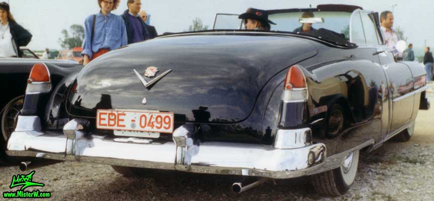 Photo of a black 1951 Cadillac Series 62 Convertible at a classic car meeting in Germany. Black 1951 Cadillac Cabrio