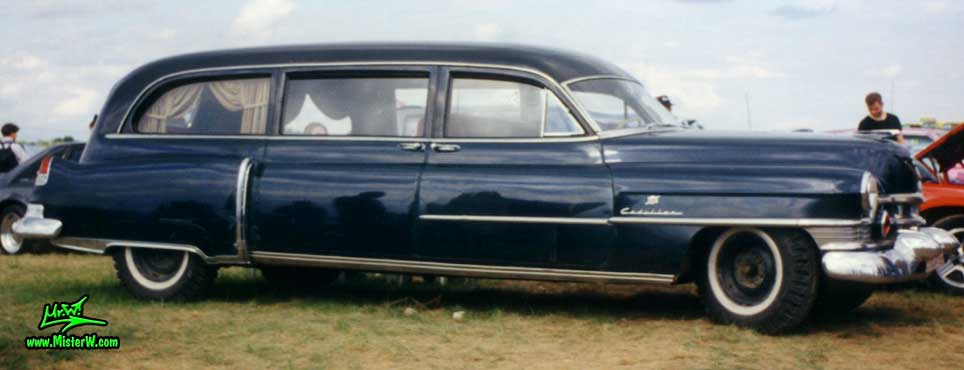 Photo of a french blue 1951 Cadillac Series 86 commercial chassis Hearse at a classic car meeting in Germany. French blue 1951 Cadillac Hearse with suicide doors