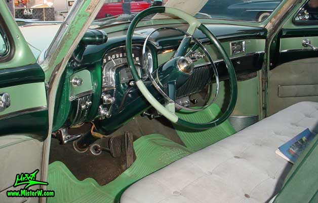 Photo of the interior & dashboard of a turquoise 1953 Cadillac Series 62 Sedan 4 Door Hardtop at a classic car meeting in Phoenix, Arizona. 1953 Cadillac Interior & Dash Board