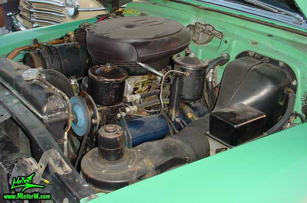 Photo of the original motor V8 engine with it's original retro oil bath air cleaner filter housing, driver side view. 1953 Caddy Engine with Oil Bath Air Cleaner
