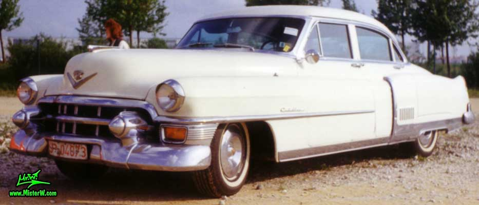 Photo of a white 1953 Cadillac Fleetwood Series Sixty Special Sedan 4 Door Hardtop at a classic car meeting in Germany. White 1953 Cadillac Fleetwood Sixty Special