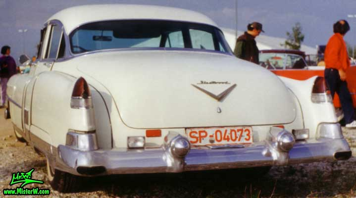 Photo of a white 1953 Cadillac Fleetwood Series Sixty Special Sedan 4 Door Hardtop at a classic car meeting in Germany. 1953 Cadillac Fleetwood Sixty Special Tail Fins