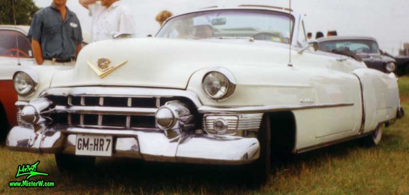 Photo of a white 1953 Cadillac Series 62 Convertible at a classic car meeting in Germany. 1953 Cadillac Series 62 Convertible