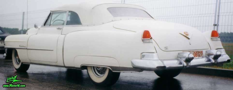 Photo of a white 1953 Cadillac Series 62 Convertible at the Wheels Nationals classic car meeting in Berlin, Germany. White 1953 Cadillac Convertible with the top closed