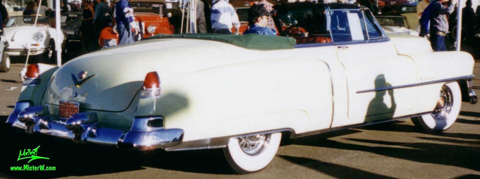 Photo of a white 1953 Cadillac Series 62 Convertible at a classic car auction in Scottsdale, Arizona. 1953 Cadillac Convertible with the top down