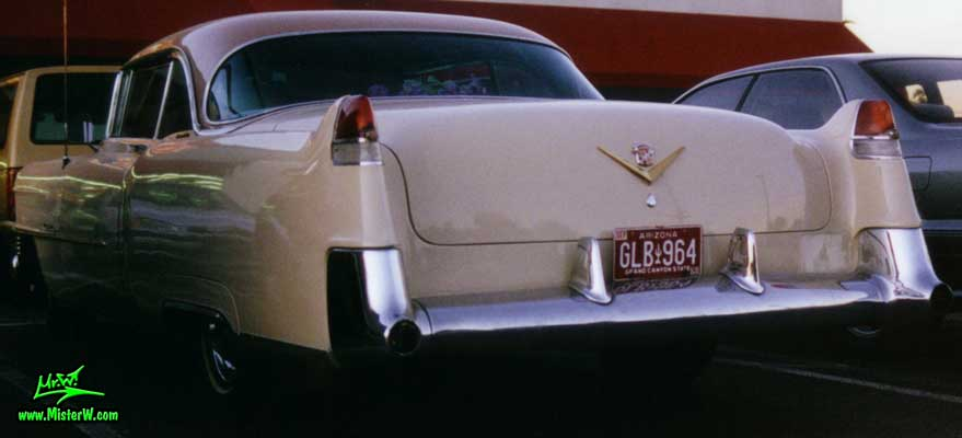 Photo of a cream colored 1954 Cadillac Series 62 Coupe 2 Door Hardtop in Scottsdale, Arizona. 1954 Caddy Tail Fins