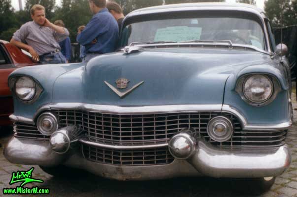 Photo of a turquoise 1954 Cadillac Series 62 Sedan 4 Door Hardtop at a classic car meeting in Germany. 1954 Cadillac Series 62 Sedan 4 Door Hardtop