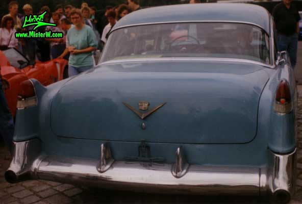 Photo of a turquoise 1954 Cadillac Series 62 Sedan 4 Door Hardtop at a classic car meeting in Germany. 1954 Caddy Sedan