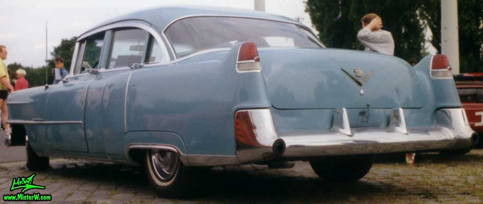 Photo of a turquoise 1954 Cadillac Series 62 Sedan 4 Door Hardtop at a classic car meeting in Germany. 1954 Cadillac Sedan Rearview