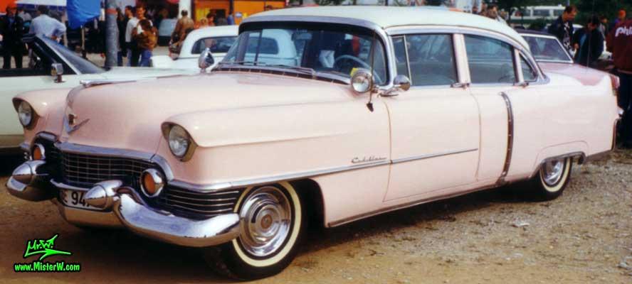 Photo of a pink 1954 Cadillac Series 62 Sedan 4 Door Hardtop at a classic car meeting in Germany. Pink 1954 Cadillac
