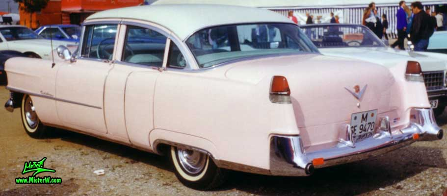 Photo of a pink 1954 Cadillac Series 62 Sedan 4 Door Hardtop at a classic car meeting in Germany. Pink 1954 Caddy