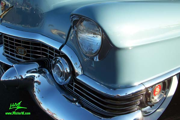 Photo of a blue 1954 Cadillac Coupe DeVille 2 Door Hardtop at the Scottsdale Pavilions Classic Car Show in Arizona. 1954 Cadillac Coupe DeVille Headlight