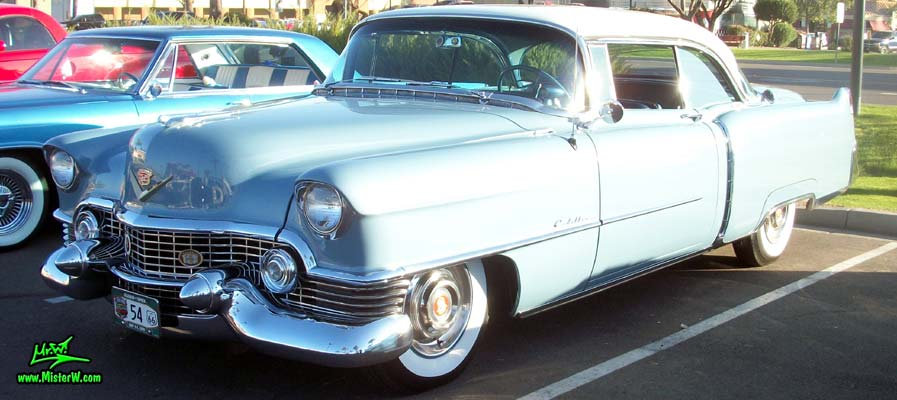 Photo of a blue 1954 Cadillac Coupe DeVille 2 Door Hardtop at the Scottsdale Pavilions Classic Car Show in Arizona. 54 Cadillac Coupe DeVille Driver Side