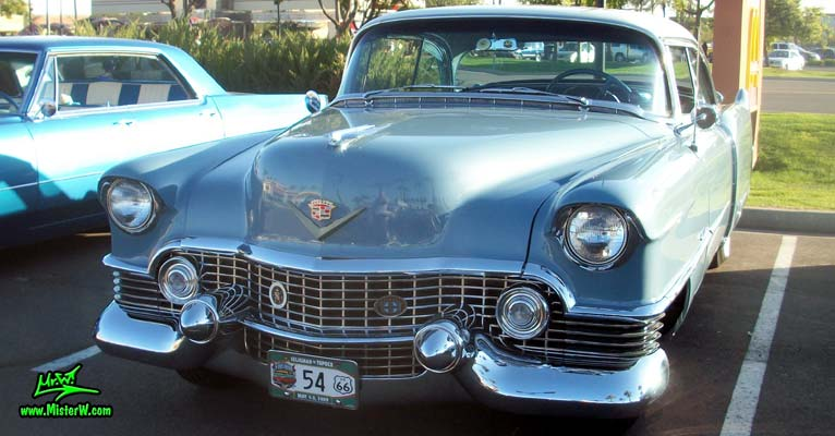 Photo of a blue 1954 Cadillac Coupe DeVille 2 Door Hardtop at the Scottsdale Pavilions Classic Car Show in Arizona. 54 Caddy Coupe DeVille Front Chrome Grill