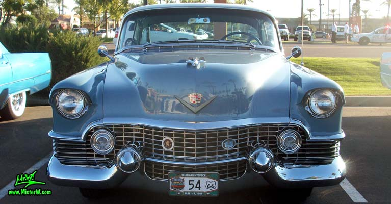 Photo of a blue 1954 Cadillac Coupe DeVille 2 Door Hardtop at the Scottsdale Pavilions Classic Car Show in Arizona. Frontview of a 1954 Cadillac Coupe DeVille 2 Door Hardtop