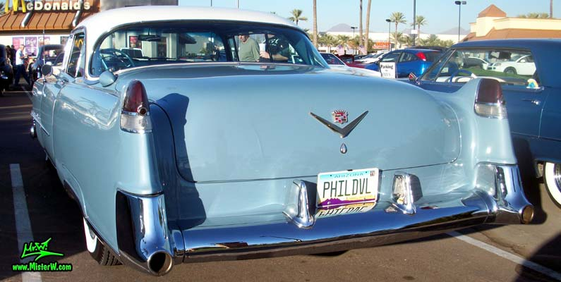 Photo of a blue 1954 Cadillac Coupe DeVille 2 Door Hardtop at the Scottsdale Pavilions Classic Car Show in Arizona. Rearview of a 1954 Cadillac Coupe DeVille 2 Door Hardtop
