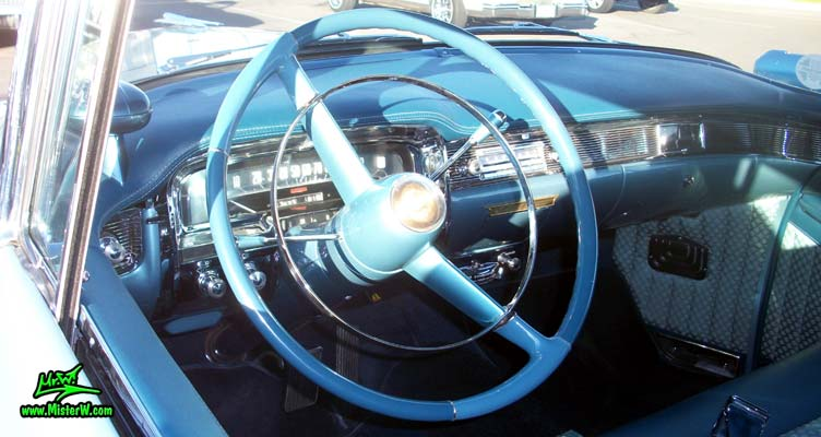 Photo of a blue 1954 Cadillac Coupe DeVille 2 Door Hardtop at the Scottsdale Pavilions Classic Car Show in Arizona. 1954 Cadillac Coupe DeVille Interior & Dashboard
