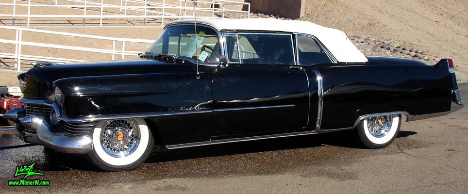 Photo of a black 1954 Cadillac Convertible at a classic car auction in Scottsdale, Arizona. Sideview of a 1954 Cadillac Convertible