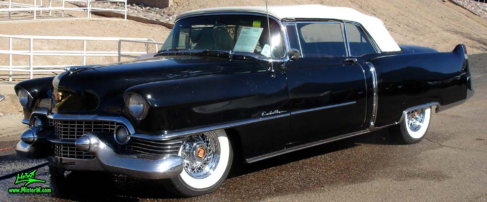 Photo of a black 1954 Cadillac Convertible at a classic car auction in Scottsdale, Arizona. Frontview of a 54 Cadillac Convertible