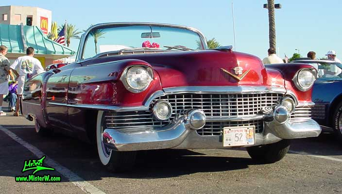 Photo of a red 1954 Cadillac Eldorado Convertible at the Scottsdale Pavilions Classic Car Show in Arizona. Frontview of a 1954 Cadillac Eldorado Convertible