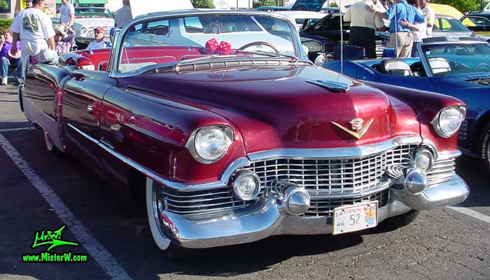 Photo of a red 1954 Cadillac Eldorado Convertible at the Scottsdale Pavilions Classic Car Show in Arizona. Red 1954 Cadillac Eldorado Convertible with Fuzzy Dice