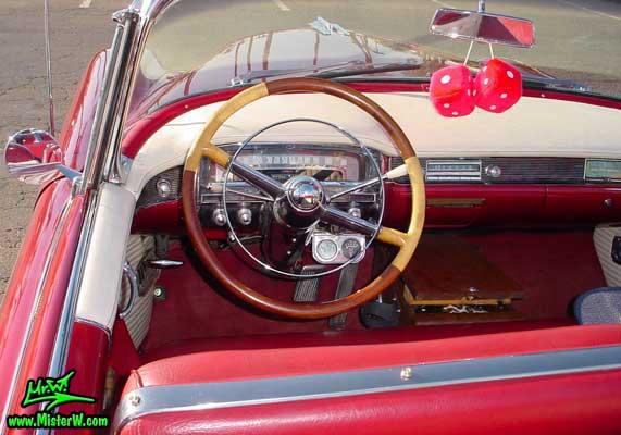Photo of a red 1954 Cadillac Eldorado Convertible at the Scottsdale Pavilions Classic Car Show in Arizona. 1954 Cadillac Eldorado Odometer & Steering Wheel