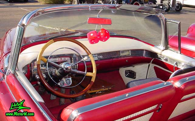 Photo of a red 1954 Cadillac Eldorado Convertible at the Scottsdale Pavilions Classic Car Show in Arizona. Red 1954 Cadillac Eldorado Convertible with white padded Dashboard