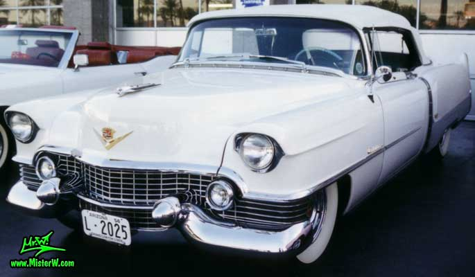 Photo of a white 1954 Cadillac Eldorado Convertible at the Scottsdale Pavilions Classic Car Show in Arizona. White 1954 Cadillac Eldorado Convertible