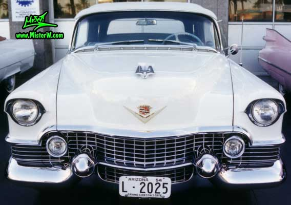 Photo of a white 1954 Cadillac Eldorado Convertible at the Scottsdale Pavilions Classic Car Show in Arizona. White 1954 Caddy Eldorado Convertible Front Grill