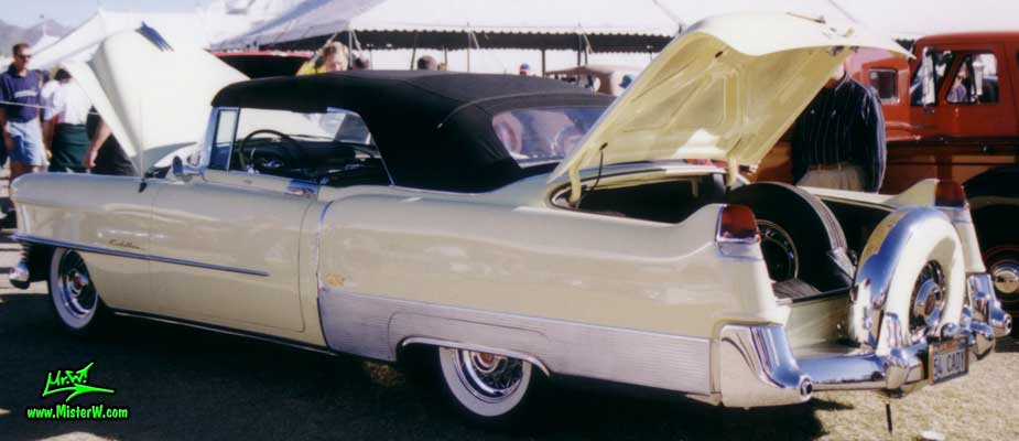 Photo of a white 1954 Cadillac Eldorado Convertible at a classic car auction in Scottsdale, Arizona. White 1954 Cadillac Eldorado Convertible with a Black Top and a Continental Kit