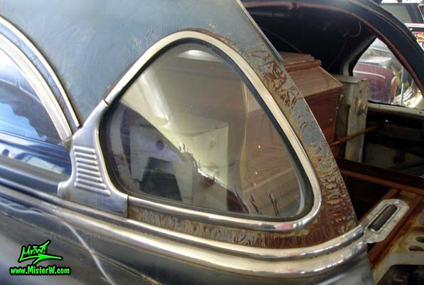 Photo of a black 1954 Cadillac Monster Garage Hearse at a classic car auction in Scottsdale, Arizona. 54 Cadillac Hearse Curved Rear Window
