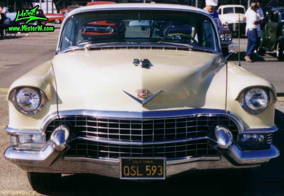 Photo of a cream colored 1955 Cadillac Coupe 2 Door Hardtop at the Pomona Classic Car Swap Meet in Los Angeles, California. 1955 Cadillac Coupe 2 Door Hardtop