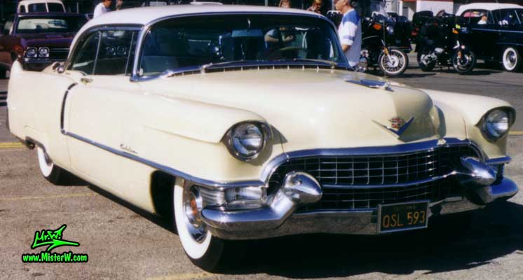 Photo of a cream colored 1955 Cadillac Coupe 2 Door Hardtop at the Pomona Classic Car Swap Meet in Los Angeles, California. 1955 Cadillac Coupe