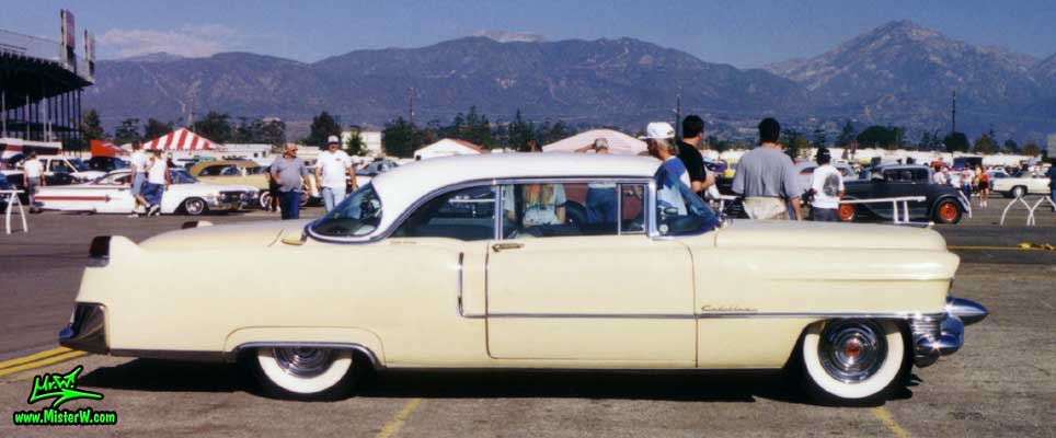 Photo of a cream colored 1955 Cadillac Coupe 2 Door Hardtop at the Pomona Classic Car Swap Meet in Los Angeles, California. 1955 Cadillac Coupe at a Classic Car Swap in Los Angeles