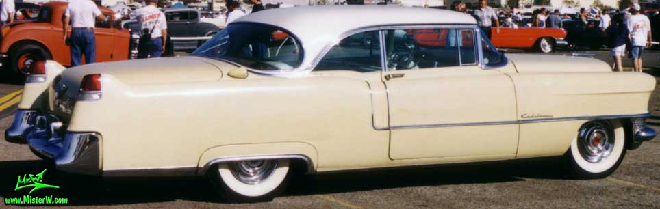 Photo of a cream colored 1955 Cadillac Coupe 2 Door Hardtop at the Pomona Classic Car Swap Meet in Los Angeles, California.
