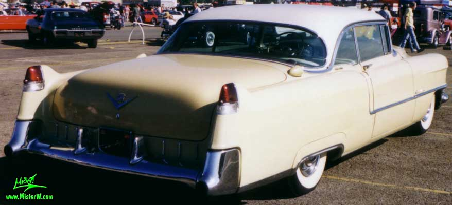 Photo of a cream colored 1955 Cadillac Coupe 2 Door Hardtop at the Pomona Classic Car Swap Meet in Los Angeles, California. Tail Fins of a 1955 Cadillac Coupe