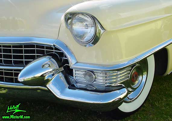 Photo of a cream colored 1955 Cadillac Coupe 2 Door Hardtop at a classic car auction in Scottsdale, Arizona. 1955 Cadillac Head Lights & Bumper