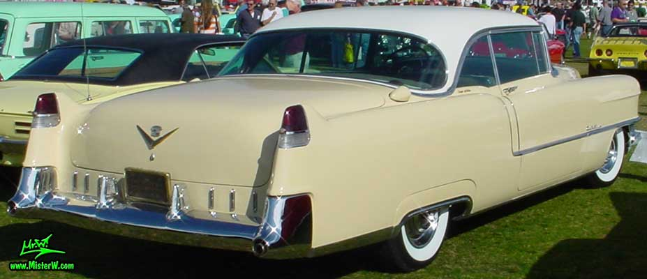 Photo of a cream colored 1955 Cadillac Coupe 2 Door Hardtop at a classic car auction in Scottsdale, Arizona. 1955 Cadillac Coupe Tailfins