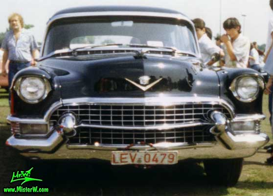 Photo of a black 1955 Cadillac Fleetwood Series 75 Limousine at a classic car meeting in K�ln Chorweiler (Cologne), Germany. 1955 Cadillac Fleetwood Series 75 Limousine