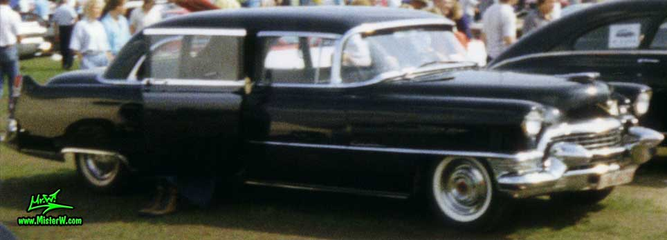 Photo of a black 1955 Cadillac Fleetwood Series 75 Limousine at a classic car meeting in K�ln Chorweiler (Cologne), Germany. Black 1955 Cadillac Limo