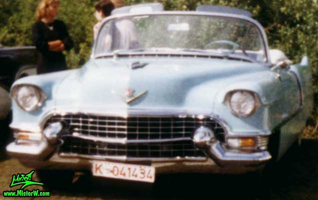 Photo of a turquoise 1955 Cadillac Series 62 Convertible at a classic car meeting in K�ln Chorweiler (Cologne), Germany. 1955 Cadillac Series 62 Convertible