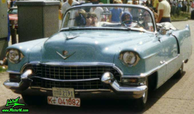 Photo of a turquoise 1955 Cadillac Series 62 Convertible at a classic car meeting in K�ln Chorweiler (Cologne), Germany. Turquoise 1955 Cadillac Convertible ariving at a classic car meeting in K�ln Chorweiler