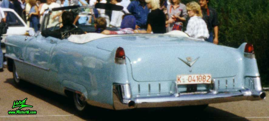 Photo of a turquoise 1955 Cadillac Series 62 Convertible at a classic car meeting in K�ln Chorweiler (Cologne), Germany. 1955 Caddy Convertible