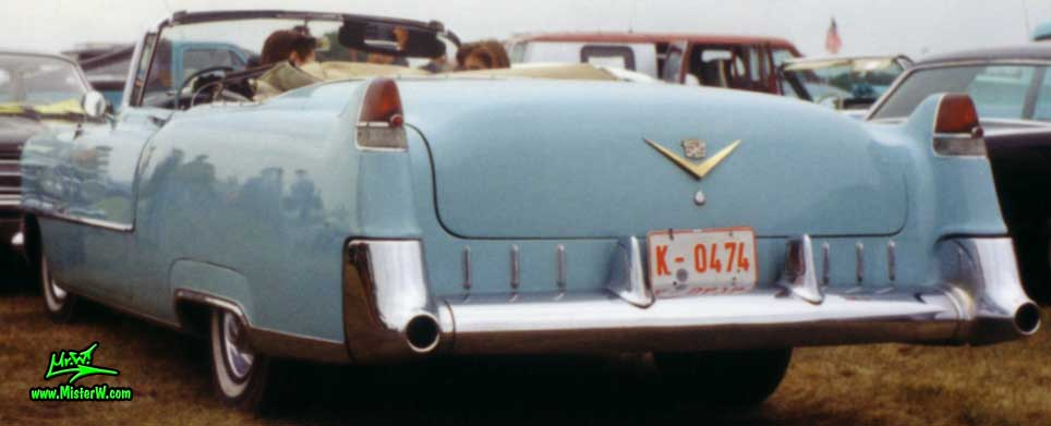 Photo of a turquoise 1955 Cadillac Series 62 Convertible at a classic car meeting in K�ln Chorweiler (Cologne), Germany. 55 Cadillac Convertible