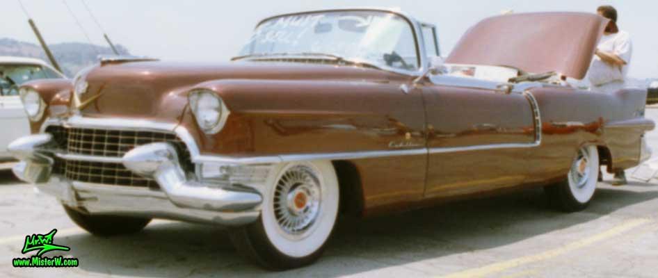 Photo of a gold brown 1955 Cadillac Eldorado Convertible at the Pomona Classic Car Swap Meet in Los Angeles, California. 1955 Cadillac Eldorado in L.A.